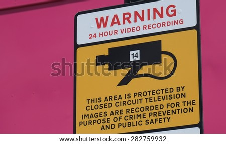 Video surveillance warning sign.