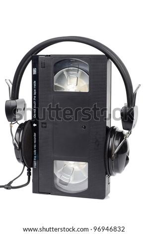 Video tape and headphone - stock photo