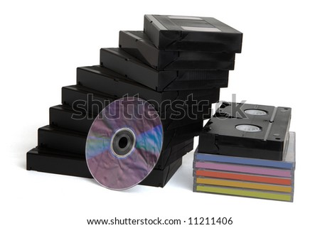 Videocassettes and dvd disk on white - stock photo