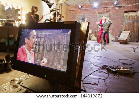 Videomonitor at movie set of musical video clip - stock photo
