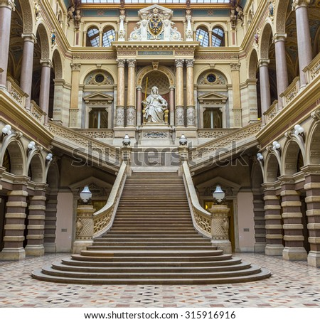 VIENNA, AUSTRIA - APR 27, 2015: neo renaissance building with statue Justice in the palace of Justice in Vienna, Austria. The palace is the seat of the supreme court in Austria.
