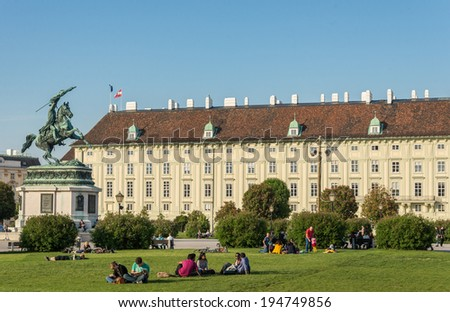 VIENNA, AUSTRIA - APRIL 27, 2014: People enjoying the spring weather in Heldenplatz, a popular and historical public place in Vienna