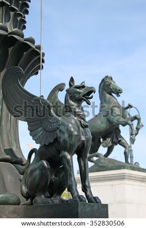 VIENNA, AUSTRIA - APRIL 22, 2010: Statue of a griffin in front of the Austrian Parliament