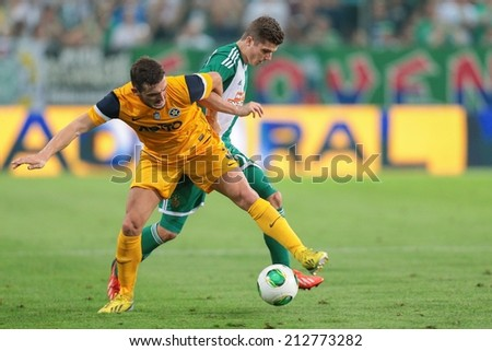 VIENNA, AUSTRIA - AUGUST 8 Christos Pipinis (#3 Asteras) and Marcel Sabitzer (#24 Rapid) fight for the ball at a UEFA Europa League game on August 8, 2013 in Vienna, Austria. - stock photo
