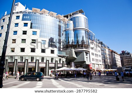 VIENNA, AUSTRIA - AUGUST 27, 2012:Haas-Haus on Stephansplatz in Vienna, Austria.  Haas-Haus building was designed by architect Hans Hollein in the postmodernist style and was completed in 1990 - stock photo