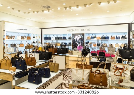 VIENNA, AUSTRIA - AUGUST 15, 2015: Michael Kors Holdings is a fashion company established in 1981 by American designer Michael Kors and is known for luxury handbags and accessories. - stock photo