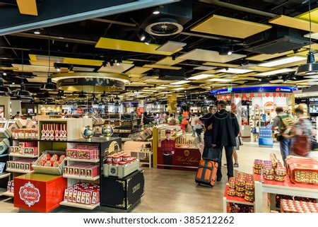 VIENNA, AUSTRIA - AUGUST 12, 2015: People Shopping In Duty Free Store Of Vienna International Airport. - stock photo