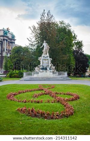 VIENNA, AUSTRIA - AUGUST 4, 2013: Statue of Amadeus Mozart with treble clef in Burggarten, Vienna, Austria - stock photo