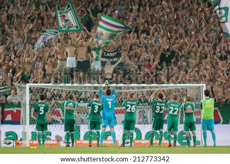VIENNA, AUSTRIA - AUGUST 8 The team of SK Rapid celebrates the victory at a UEFA Europa League game on August 8, 2013 in Vienna, Austria. - stock photo