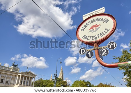 VIENNA, AUSTRIA - AUGUST 14, 2016: Tram stop sign in front of Austrian Parliament building. Vienna Tram network is one of the largest in the world.