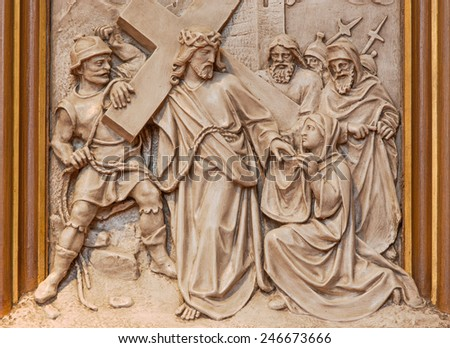 VIENNA, AUSTRIA - DECEMBER 17, 2014: Veronica wipes the face of Jesus.  Relief as one part of Cross way cycle in Sacre Coeur church by R. Haas from end of 19. cent.