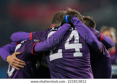 VIENNA, AUSTRIA - DEZEMBER 11 Roman Kienast (#24 Austria) and his teammates celebrate the victory at a UEFA Champions League game on Dezember 11, 2013 in Vienna, Austria. - stock photo
