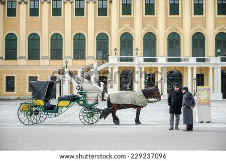 VIENNA, AUSTRIA/EUROPE - SEPTEMBER 23 : Horse and carriage at the Schonbrunn Palace in Vienna Austria on September 23, 2014. Unidentified people.
