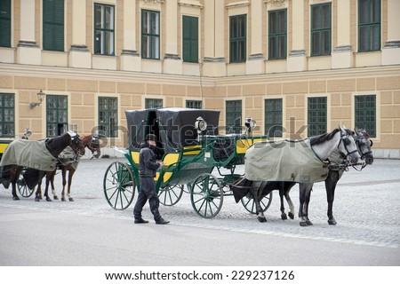 VIENNA, AUSTRIA/EUROPE - SEPTEMBER 23 : Horse and carriage at the Schonbrunn Palace in Vienna Austria on September 23, 2014. Unidentified man. - stock photo
