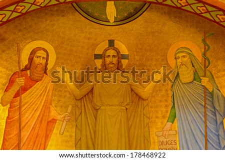 VIENNA, AUSTRIA - FEBRUARY 17, 2014: Fresco of Jesus with the Moses and Eliah by P. Verkade (1927) from side altar in Carmelites church in Dobling. - stock photo