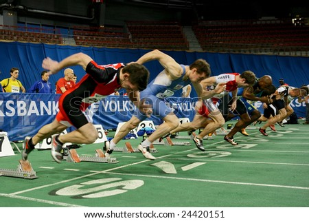 VIENNA, AUSTRIA - FEBRUARY 3, 2009: International indoor track and field meeting in Vienna: Start of the men's 60m sprint event. - stock photo