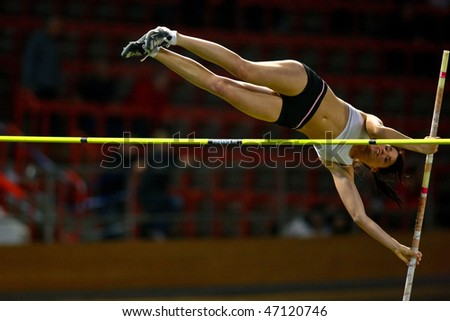 VIENNA,  AUSTRIA - FEBRUARY 16:  Vienna indoor  track and field meeting.  Eros Eniko (Hungary) places 3rd in the women's pole vault  event on February 16, 2010 in Vienna, Austria. - stock photo