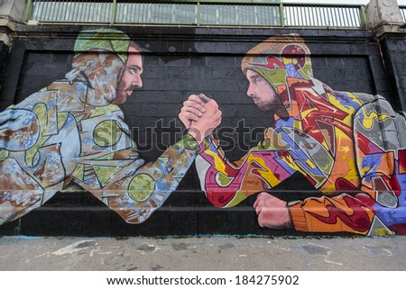 VIENNA, AUSTRIA - FEBRUARY 5, 2014: View at graffiti on the wall in Vienna. City of Vienna with project Wienerwand (Vienna Wall) offers young artists from the graffiti scene legal areas for their art. - stock photo