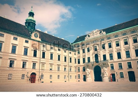Vienna, Austria - Hofburg Palace courtyard. The Old Town is a UNESCO World Heritage Site. Retro color style - cross processed filtered colors tone. - stock photo