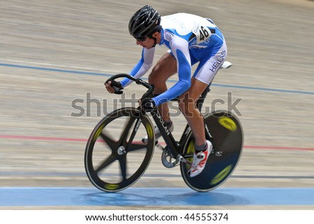 VIENNA,  AUSTRIA - JANUARY 11 Indoor track cycling meeting - Dimitri  Polydoropoulos (Greece) places sixth in the men's point race qualification on January 11, 2010 in Vienna, Austria. - stock photo