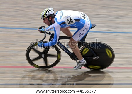 VIENNA,  AUSTRIA - JANUARY 11 Indoor track cycling meeting - Dimitrios Chidemenakis (Greece) places twelth in the men's point race qualification on January 11, 2010 in Vienna, Austria. - stock photo