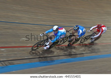 VIENNA,  AUSTRIA - JANUARY 12 Indoor track cycling meeting - Tomas Babek (Czech Republic, left) places second in the men's keirin race on January 12, 2010 in Vienna, Austria. - stock photo