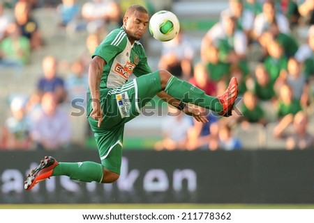 VIENNA, AUSTRIA - JULY 12 Terrence Boyd (#9 Rapid) kicks the ball at a friendly soccer game on July 12, 2013 in Vienna, Austria. - stock photo