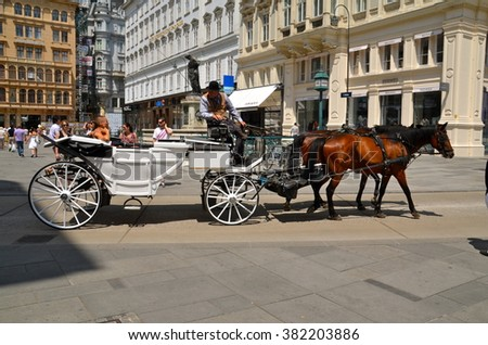 VIENNA, AUSTRIA - JUN 23, 2013: Couple Horse-drawn cart for tourists on Graben in Vienna, Austria