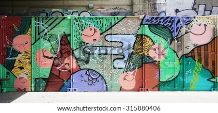VIENNA, AUSTRIA -24 JUNE 2015- Creative graffiti street art murals line the streets and back alleys of Vienna, the capital of Austria, especially along the banks of the Danube River and its canals.