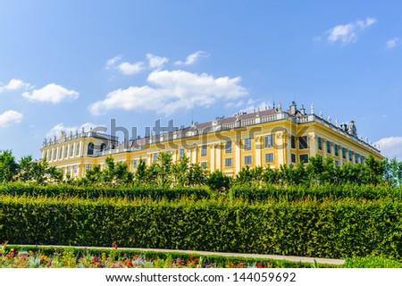 VIENNA, AUSTRIA - JUNE 17: Schonbrunn Palace and gardens on June, 17, 2013 in Vienna, Austria. One of the most important cultural monuments and one of the major tourist attractions in Vienna - stock photo