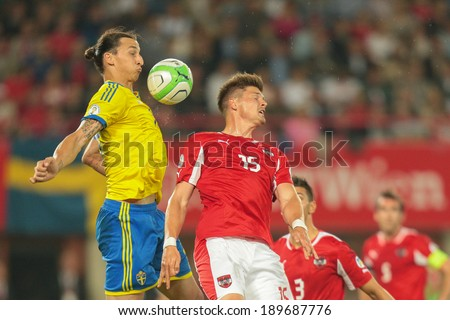 VIENNA,  AUSTRIA - JUNE  7 Sebastian Proedl (#15 Austria) and Zlatan Ibrahimovic (#10 Sweden) fight for the ball during the world cup qualifier game on June 7, 2013 in Vienna, Austria. - stock photo