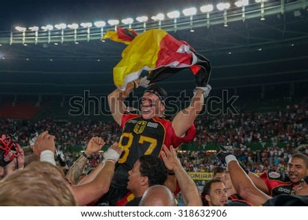 VIENNA, AUSTRIA - JUNE 7, 2014: WR Jan Hilgenfeldt (#87 Germany) celebrates the win of his team in the finals. - stock photo