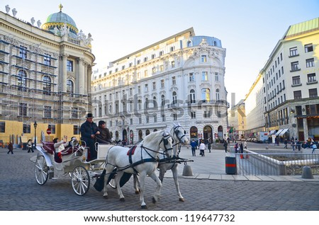 VIENNA, AUSTRIA - MAR 15: Fiaker in front of cafe Griensteidl on March 15,2012 in Vienna, Austria. The cafe opened in 1847 by owner Heinrich Griensteidl and is still a meeting place for artists. - stock photo