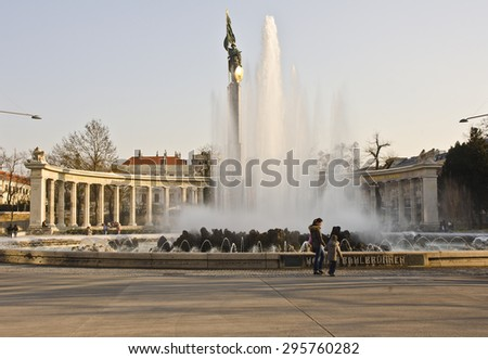 VIENNA, AUSTRIA - MARCH 19: Hochstrahlbrunnen viewed from Schwarzenbergplatz on March 19, 2015 in Vienna, Austria. The Hochstrahlbrunnen fountain was built in 1873 and remodeled in 1906. - stock photo