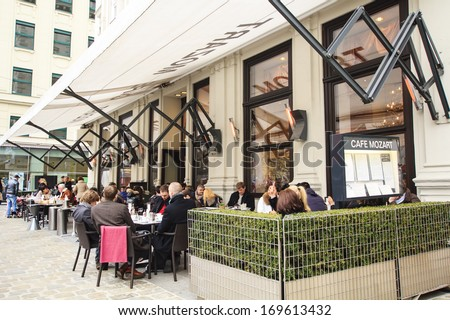 VIENNA, AUSTRIA - MARCH 10 : People enjoying coffee and pastries at the outside terrace of the famous Cafe Mozart in Vienna on March 10th, 2013 in Vienna, Austria - stock photo