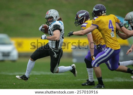 VIENNA, AUSTRIA - MARCH 23, 2014: RB Andreas Hofbauer (#29 Raiders) runs with the ball in an AFL football game. - stock photo