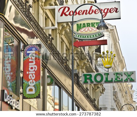 VIENNA, AUSTRIA - MARCH 19: shop-front sign of Desigual and other famous brands on March 19, 2015 in Vienna, Austria. Desigual is a Spanish clothing retailer with over 3,500 employees worldwide. - stock photo