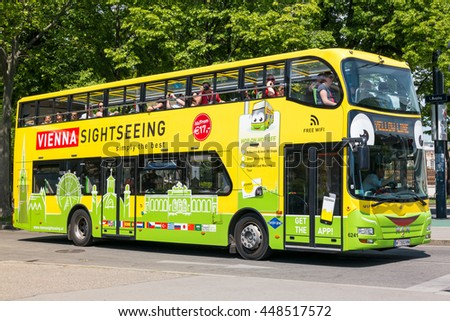 VIENNA, AUSTRIA - MAY 23, 2016: Tourists on hop on hop off bus of yellow line sightseeing inner city of Vienna, Austria