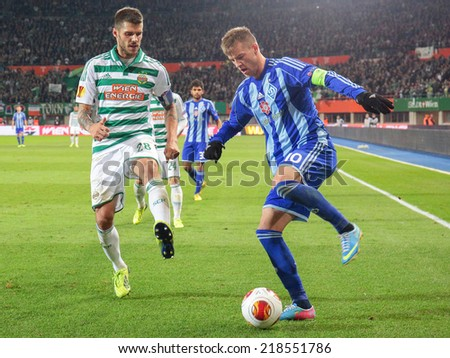 VIENNA, AUSTRIA - OCTOBER 3 Andriy Yarmolenko (#10 Kiew) and Christopher Trimmel (#28 Rapid) fight for the ball at a UEFA Europa League game on OCTOBER 3, 2013 in Vienna, Austria. - stock photo