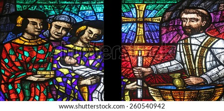 VIENNA, AUSTRIA - OCTOBER 11: Asia window, Stained glass in Votiv Kirche (The Votive Church). It is a neo-Gothic church in Vienna, Austria on October 11, 2014 - stock photo