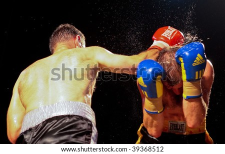 VIENNA, AUSTRIA - OCTOBER 3 Charity Boxing:  Chussein Dombaev (left, Austria) beats Michael Tomko (right, Slovakia) in a  super middelweight fight on October 3, 2009 in Vienna,  Austria. - stock photo