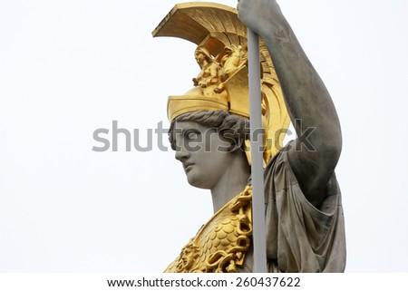 VIENNA, AUSTRIA - OCTOBER 11: Pallas Athene greek goddess of wisdom in front of Austrian parliament, Vienna, Austria on October 11, 2014. - stock photo