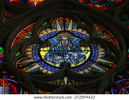 VIENNA, AUSTRIA - OCTOBER 10: Saint John the Evangelist, Stained glass in Votiv Kirche (The Votive Church). It is a neo-Gothic church in Vienna, Austria on October 10, 2014 - stock photo