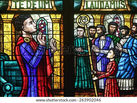 VIENNA, AUSTRIA - OCTOBER 11: Stained glass in Votiv Kirche (The Votive Church). It is a neo-Gothic church located on the Ringstrabe in Vienna, Austria on October 11, 2014 - stock photo