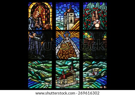 VIENNA, AUSTRIA - OCTOBER 11: Stained glass that shows pilgrimage to Mariazell, Votiv Kirche (The Votive Church). It is a neo-Gothic church in Vienna, Austria on October 11, 2014 - stock photo
