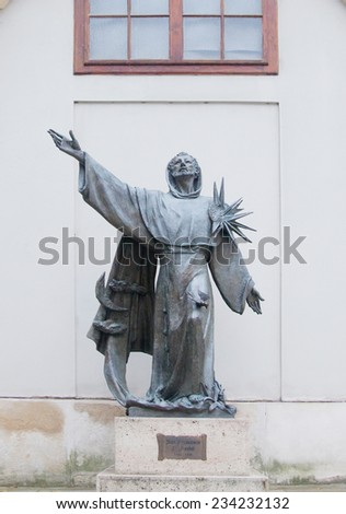 Vienna, Austria - October 11: Statue of Saint Francis of Assisi in Vienna, Austria on October 11, 2014. It was installed on the north side of Minoritenkirche church in 2003. - stock photo