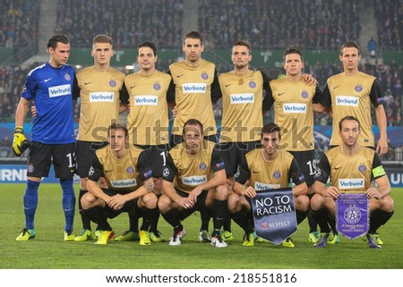 VIENNA, AUSTRIA - OCTOBER 22 The team of FK Austria Wien poses before a UEFA Champions League game against Atletico Madrid on October 22, 2013 in Vienna, Austria. - stock photo