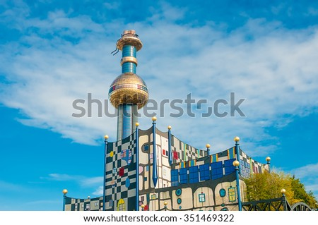 VIENNA, AUSTRIA - OCTOBER 16, 2015: Tower of Garbage-processing plant in Vienna, Austria.  Designed by Friedensreich Hundertwasser. It was inaugurated in 1992 and heats 60000 apartments.  - stock photo
