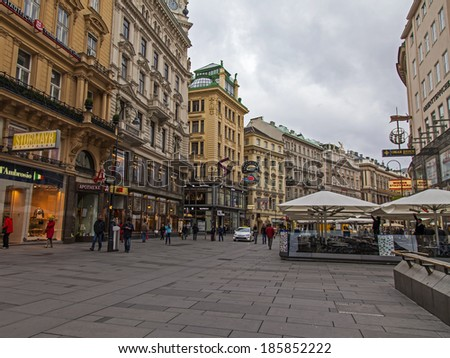 Vienna, Austria, on March 24, 2014. Tourists walk down the street Kertner of Shtrasse in the cloudy spring afternoon