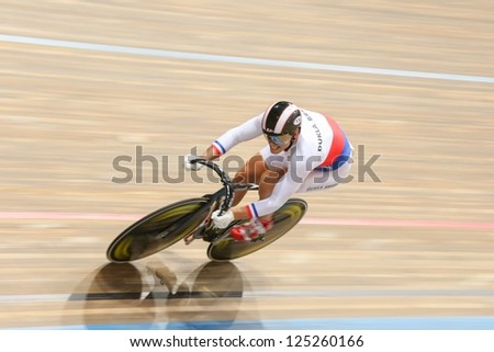 VIENNA,  AUSTRIA - SEPTEMBER 27  Lubomir Vojta (Czech Republic) competes in the men's team sprint event of an indoor cycling meeting on September 27, 2012 in Vienna, Austria. - stock photo
